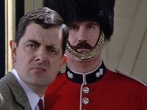 Humor video E-cards, Mr Bean tries to take a picture of one of the Queen s guards but can t get the funny humor