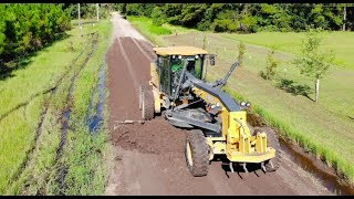 Heavy Equipment Road Grader And Dump Truck With Drone