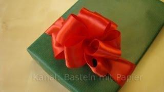 Geschenkband binden geschenk verpacken 123vid for Schleife binden youtube