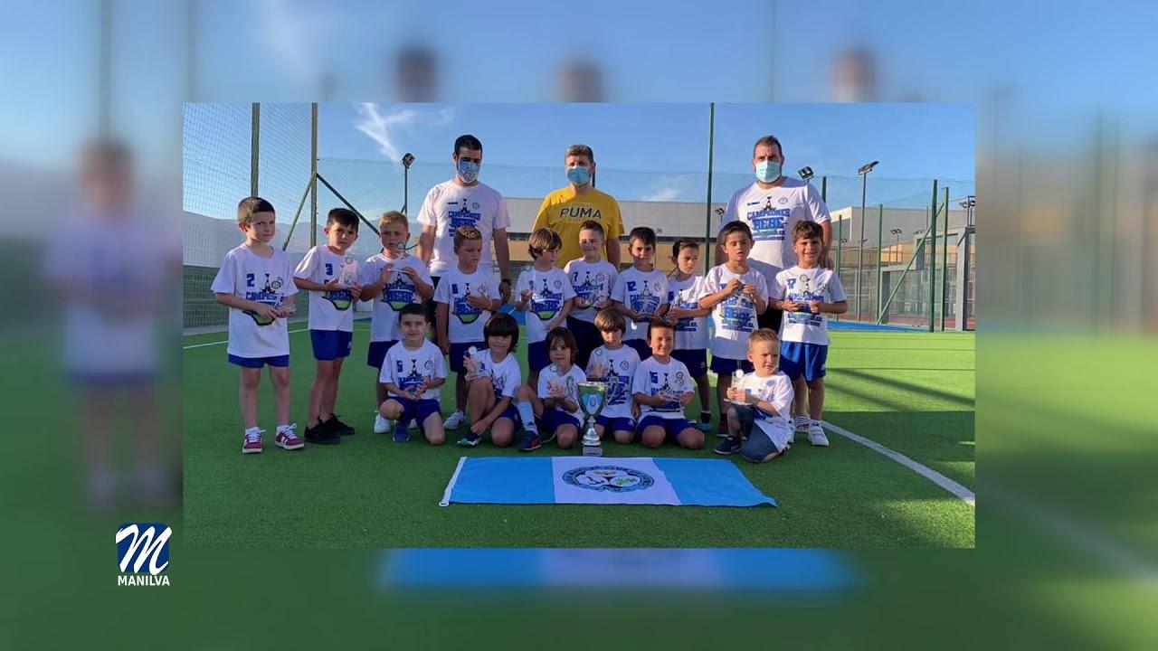 La Unión Manilva bebé recibe el trofeo de campeones de liga