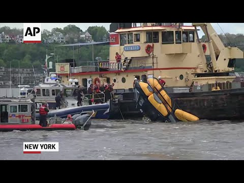 A helicopter that crashed into the Hudson River near a busy NYC heliport Wednesday and partially sank, was pulled from the water. New York City officials said the pilot was able to escape, and was being treated for non-life-threatening injuries. (May 15)