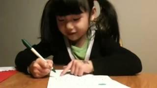 Jojo writing mom a Christmas card