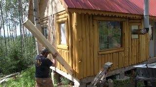 Alaska Log Cabin Project  .....putting in the final logs