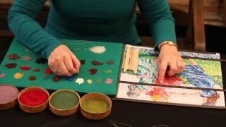 Tineke Nieuwenhuijse demonstrates how to bead a bag