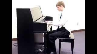 <b>Philip Lindholm</b> Playing A Piano Solo Of The Hymn When I Survey The Wondrous Cross
