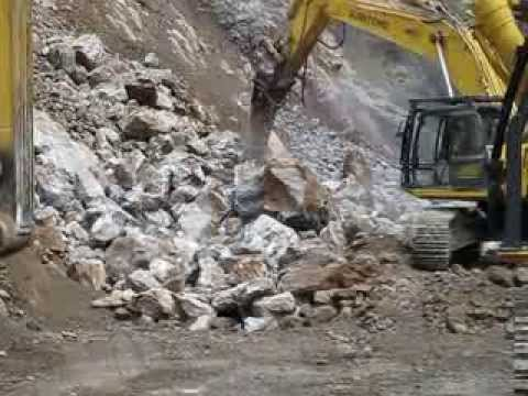 Rammer Large Range Hammer being using to clear a Landslide