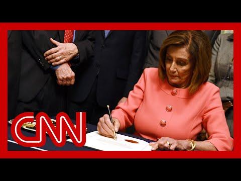 Pelosi signs impeachment articles against President Trump