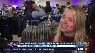 Hundreds wait in line for grand opening of Ravens pop-up shop