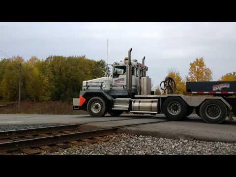Nuclear waste truck clears railroad track in guys neighborhood