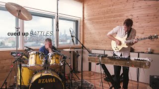 "BATTLES Performs ""Titanium 2 Step"" And ""Fort Greene Park"" Live In Brooklyn 
