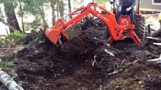 """Successfully moving large  Tree stump with Kubota tractorB2650 with 7'7"""" backhoe and la534 loader"""