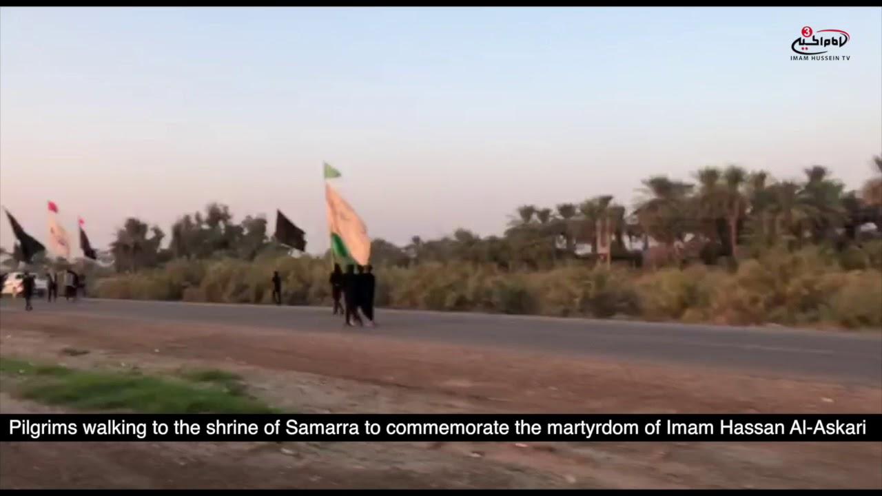 Watch pilgrims walking to the city of Samarra