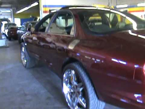 Lifted Oldsmobile Aurora bubble with 24 inch rims from Dragg City!