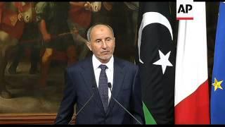 Libyan leader Jalil meets Italian PM; handshake, statement
