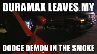 Duramax Leaves Dodge Demon In Smoke at drag strip