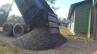 Kubota Skidsteer Spreading Gravel
