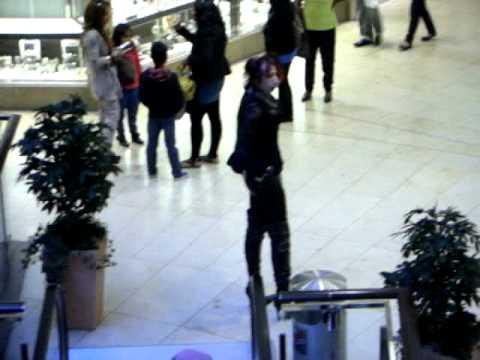 Fetish Mistress Hoellenbraut walking  in shopping mall