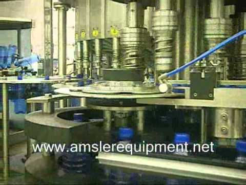 Rotary Filling Systems - Rinsing Filling & Capping Bottle filler sold by Amsler Equipment
