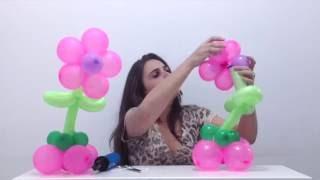 """Aprenda como fazer uma flor de centro de mesa com balões. É uma ótima ideia de decoração de balões / escultura de bexigas.   Quer aprender mais dicas sobre festas, festa infantil e decoração de balões / bexigas? Conheça a Amo Festas!  - Visite nosso site e comunidade - http://amofestas.com - Curta nossa página no Facebook - http://facebook.com/amofestas  - Gostou? Então clique em """"Gostei"""" e compartilhe com suas amigas e familiares."""