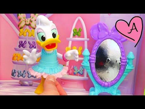 Juguetes de Disney - DAISY VA A LA FIESTA DE CUMPLEAÑOS DE MINNIE - Juego de vestir a Daisy