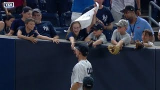 Judge gives young girl a ball in the stands