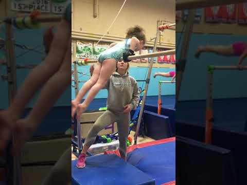 Fiona uses the Limb Difference aid on the asymmetric bars