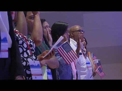 Fifty-two citizenship candidates from over 25 countries took the Oath of Allegiance to become America's newest citizens Tuesday during a naturalization ceremony held at the 9/11 Memorial & Museum in New York. (July 2)