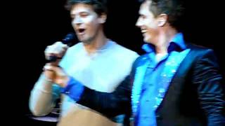 John Barrowman with his partner Scott Gill singing live