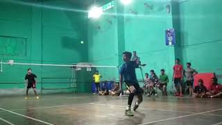 National level players playing badminton