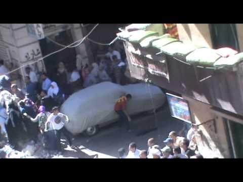 مدرعة تدهس المتظاهرين بمنطقة سيدى بشر11-10-2013
