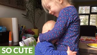 This Baby Cuddling With Her Sister Will Melt Your Heart!