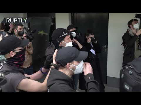 Scuffles erupt during left-wing march against police racism in Berlin