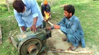 Peter Diesel Engine  Start up Tube Well agricultural system in Rural area Village of Punjab