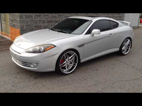 "2007 HYUNDAI TIBURON SITTING ON 20"" ROSSO REACTIVE CHROME WHEELS AND 245/35-20 CARBON TIRES"