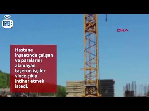 Sakarya'da hastane inşaatında çalışan ve paralarını alamayan taşeron işçiler vincin tepesine çıktı
