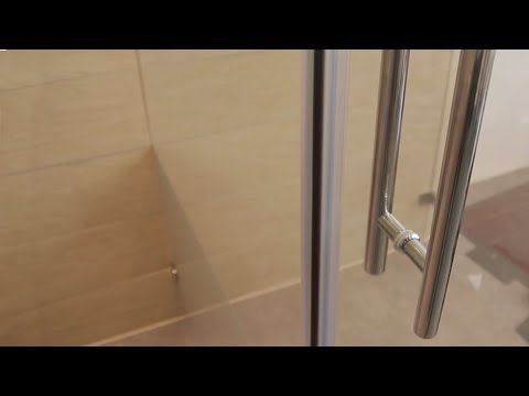 Griffstange aus Edelstahl an Glas-Duschtür montieren