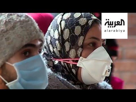 العرب اليوم - شاهد: مشهد كوروني فريد في شوارع القاهرة لوجوه تكسوها الكمامات