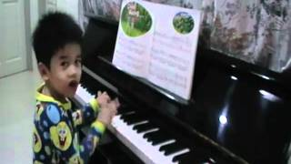 3 year old playing piano Gerald Ong