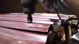 Fitting Amano roofing sheet to Aluminium bar with Amano Hexagon bolt using Electric Drill.