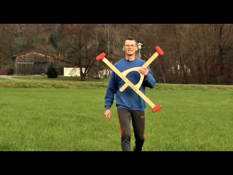 Man builds giant boomerangs that fly more than 250 feet away and he can still catch them.