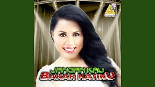 Download lagu Rita Sugiarto Jangan Kau Bakar Hatiku Mp3