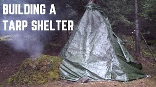 HOW TO BUILD A SHELTER WITH STONES AND TARP