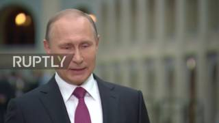 Russia: Putin says work in KGB had ties to non-official intelligence