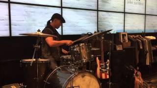 Playing drums in John Varvatos