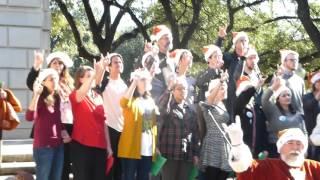 Santa sings The Eyes of Texas at the UT tower