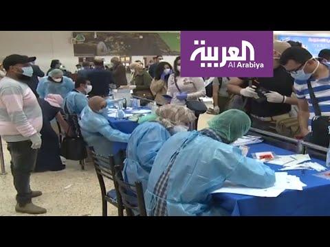 العرب اليوم - شاهد: عودة فلسطينيين كانوا بالحجر في فنادق البحر الميت الأردنية