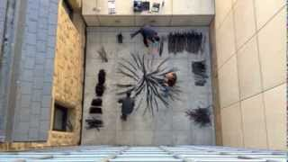 Museum Installation Team Installs Andy Goldsworthy's Burnt Patch, SJMA