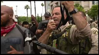 Riverside County Sheriff kneels with protesters in Riverside.mp4