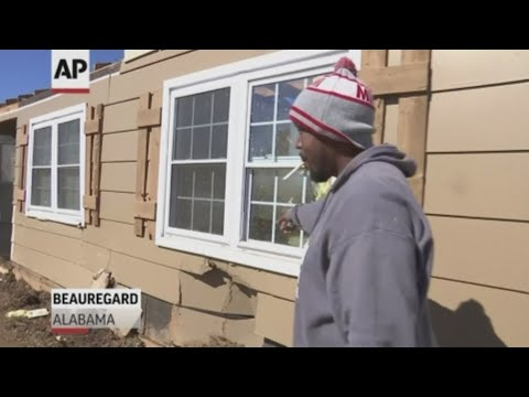Jaron Washington was inside his Beauregard, Alabama home when he says Sunday's tornado lifted it off its foundation and dropped it forty feet away. Miles away, in Smith Station, volunteers started to clean up the mess the storm left behind. (March 5)
