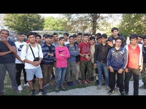 Many Afghan migrants meet in a park in central Belgrade
